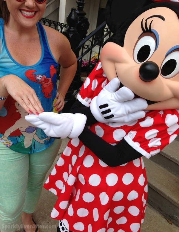 Minnie Mouse loving her OPI Couture de Minnie nail polish colors.
