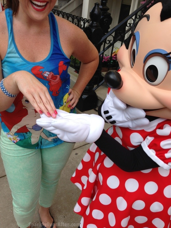 Minnie Mouse admiring the 2013 Minnie OPI nail polish colors.