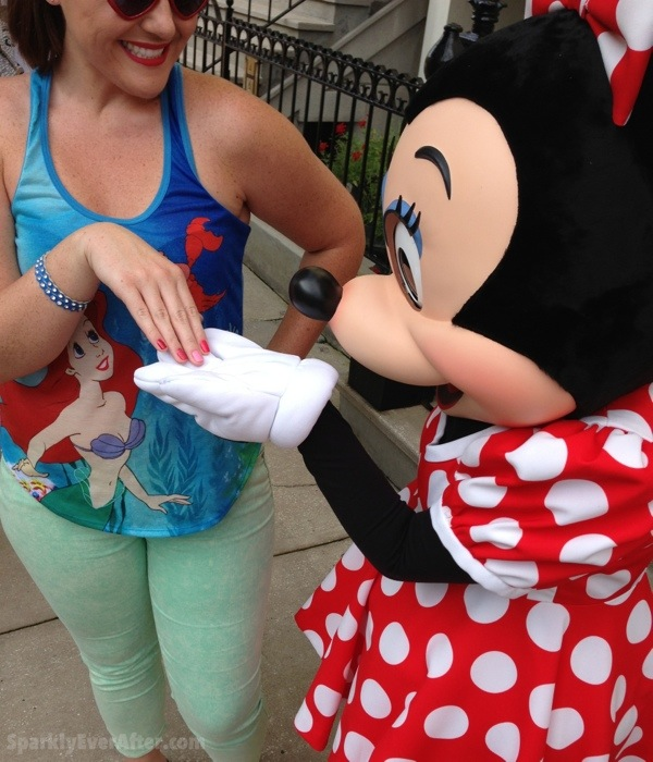 Minnie Mouse admiring the OPI Couture de Minnie nail polish colors