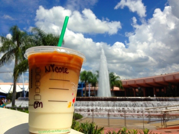 Latte with a view. Enjoying a Starbucks caramel macchiato with a view of EPCOT's Fountain of Nations